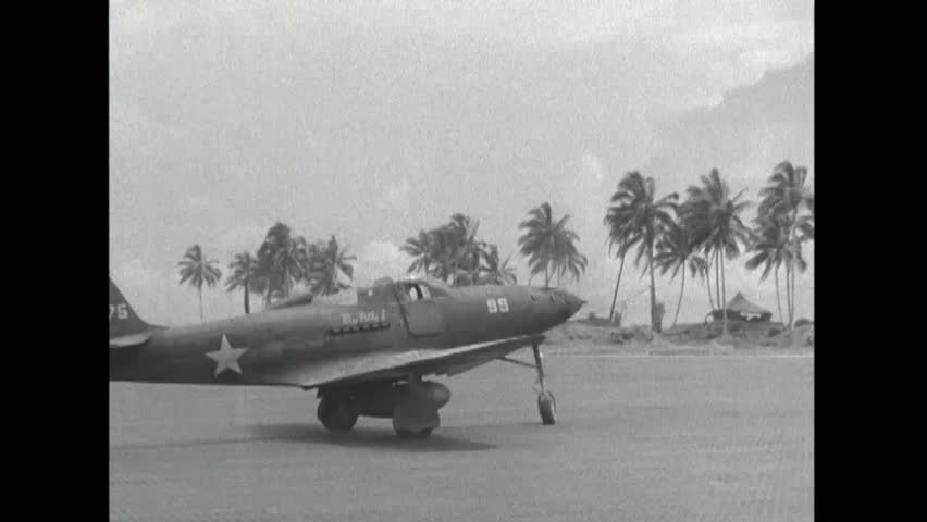 CIRCA 1943 - Allied aircrafts land and taxi on Bougainville Island.