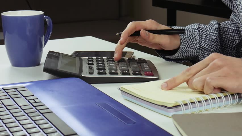 Accountant or manager making calculations and taking notes in notebook at work. Business, accounting, finance, work. | Shutterstock HD Video #1022932429