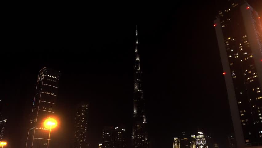 DUBAI, UNITED ARAB EMIRATES - DECEMBER 31, 2018: Burj Khalifa at night sparkles with bright lights   Shutterstock HD Video #1022936374