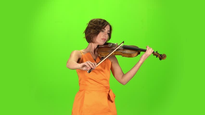 Musician in the studio plays the violin. Green screen