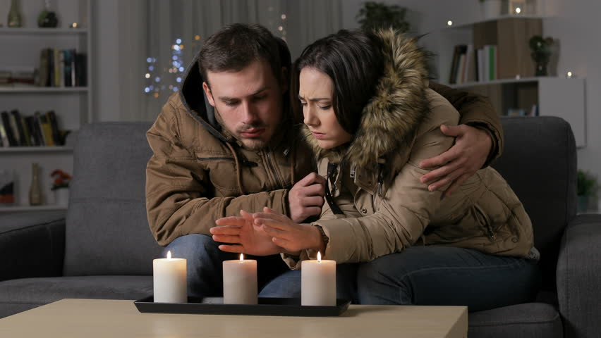 Angry couple getting cold at home suffering a power outage sitting on a couch in the night Royalty-Free Stock Footage #1022986990