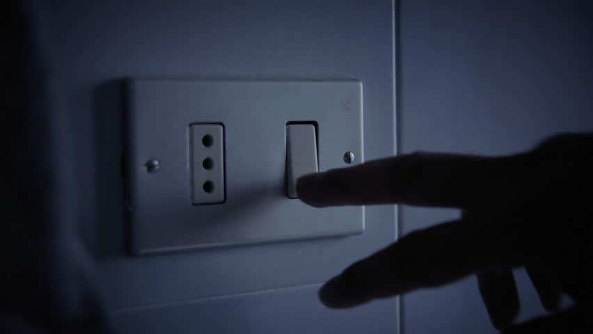 A hand turning the light switch on and off. Int. day, detail close-up shot.  | Shutterstock HD Video #1022990047