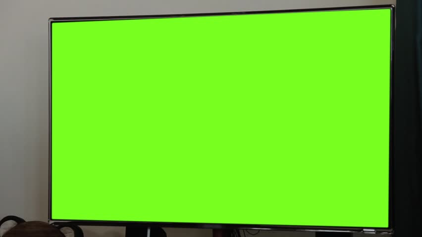 """LCD Television with Green Screen. Zoom In Shot. You can replace green screen with the footage or picture you want. You can do it with """"Keying"""" (Chroma Key) effect (check out tutorials on YouTube). 