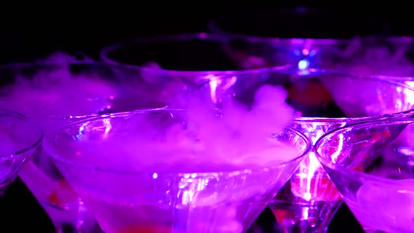 Pyramid of champagne with liquid nitrogen. Colorful lights led   Shutterstock HD Video #1023029251
