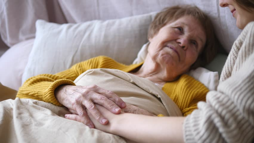 Family Values, Support, Elderly Care, Assistance, Seniors Concept. Grandmother In Bed. | Shutterstock HD Video #1023050506