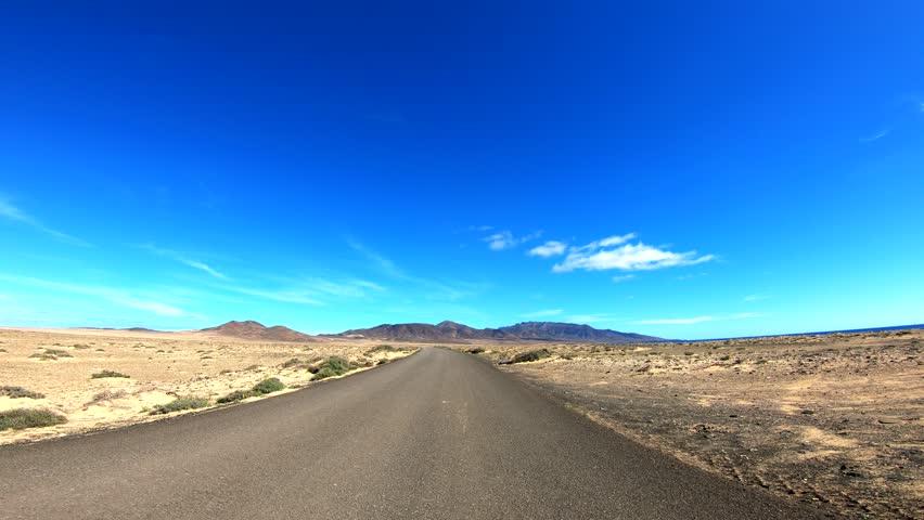 P.O.V. trip in a desert. Fuerteventura | Shutterstock HD Video #1023056566
