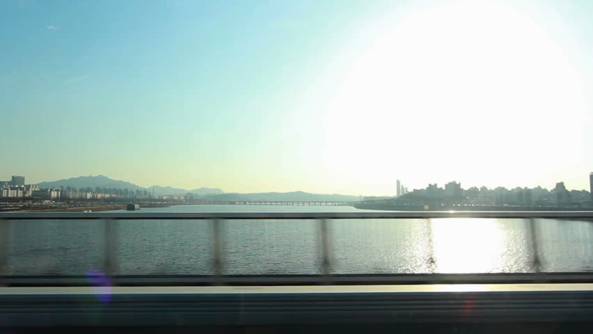Moving scenery seen through the windows of a vehicle at Seoul, South Korea | Shutterstock HD Video #1023062518