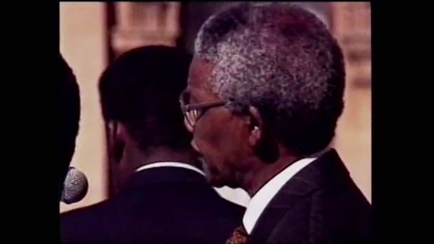 Cape Town, South Africa. July 1991. Nelson Mandela speaks to the crowd  and takes an oath after his election as President of South Africa.