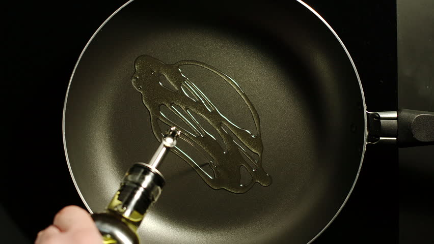 Man pouring cooking oil on the frying pan - Top View | Shutterstock HD Video #1023112441