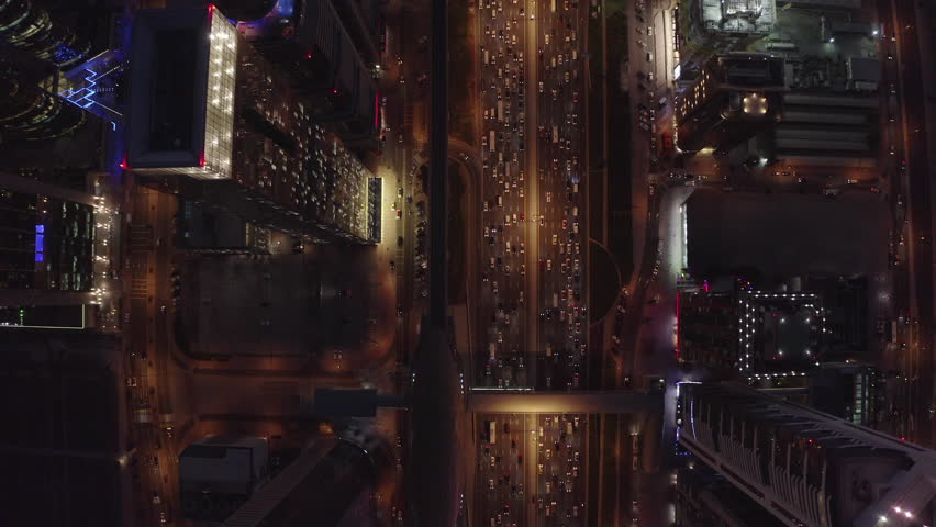 Aerial drone video of moving traffic at night. Sheikh Zayed Road. Main highway of Dubai.