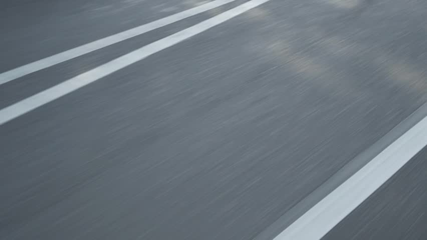 Filming Road asphalt by driving a car day light blurry blured motion road stripes   Shutterstock HD Video #1023131794