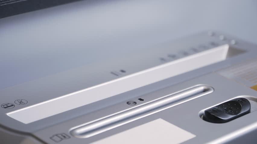 Document shredded by shredder | Shutterstock HD Video #1023132361