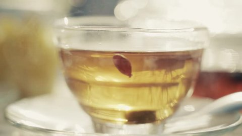 Hot fruity drink in the cup is steaming