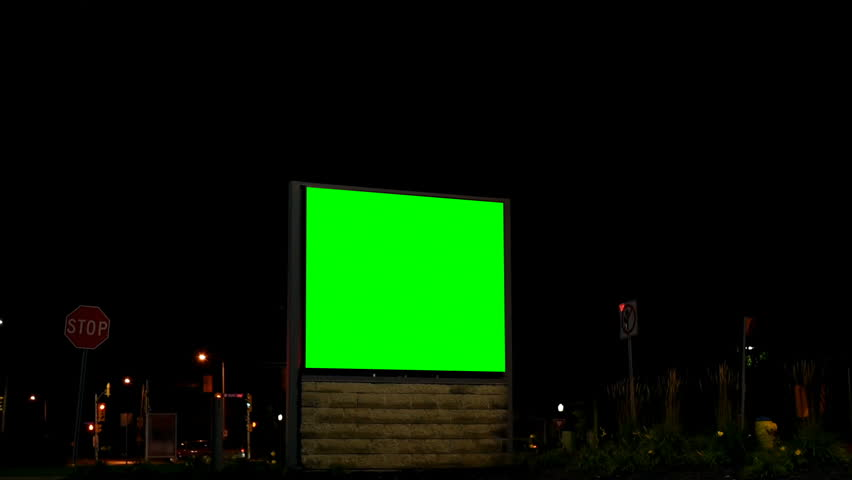 Empty billboard with chroma key green screen at night. Street lights and moving vehicle in the dark  | Shutterstock HD Video #1023148267
