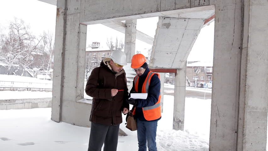 The customer, a business man, discusses the construction of his new shopping center with the architect and engineer. Plan, work   Shutterstock HD Video #1023153181