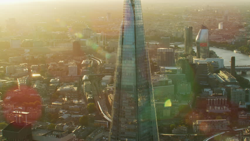 London UK - November 2017: Aerial sunset view with sun flare Shard modern glass skyscraper London cityscape residential and commercial buildings England UK RED WEAPON