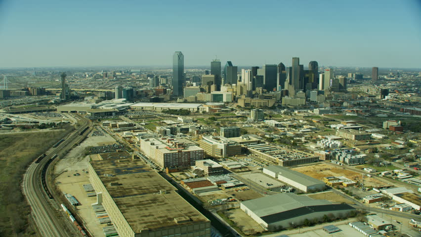 Aerial view of city vehicle freeway Railroad freight yard downtown urban skyscrapers Dallas Texas USA RED WEAPON | Shutterstock HD Video #1023166705