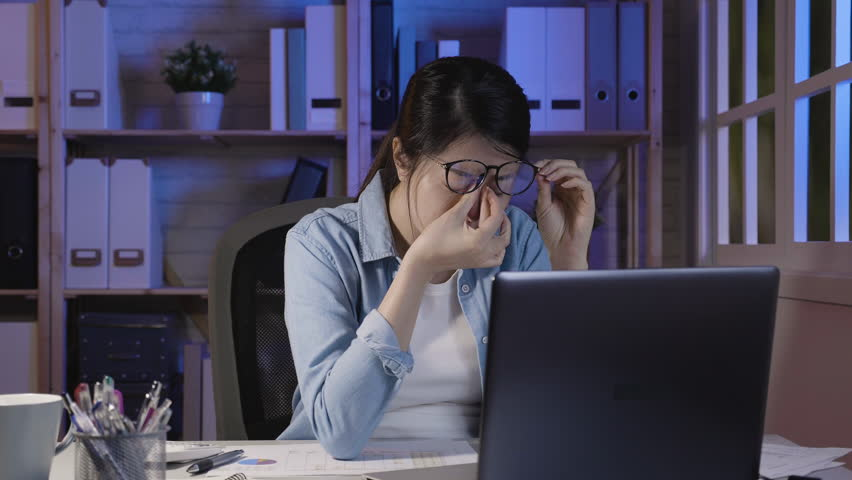 Slow motion of beautiful woman working late at home. Tired young white collar female worker rubbing eyes while sitting in front of laptop computer on promising project in house office at night. | Shutterstock HD Video #1023172354