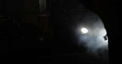 Vehicle Lights at Night on road