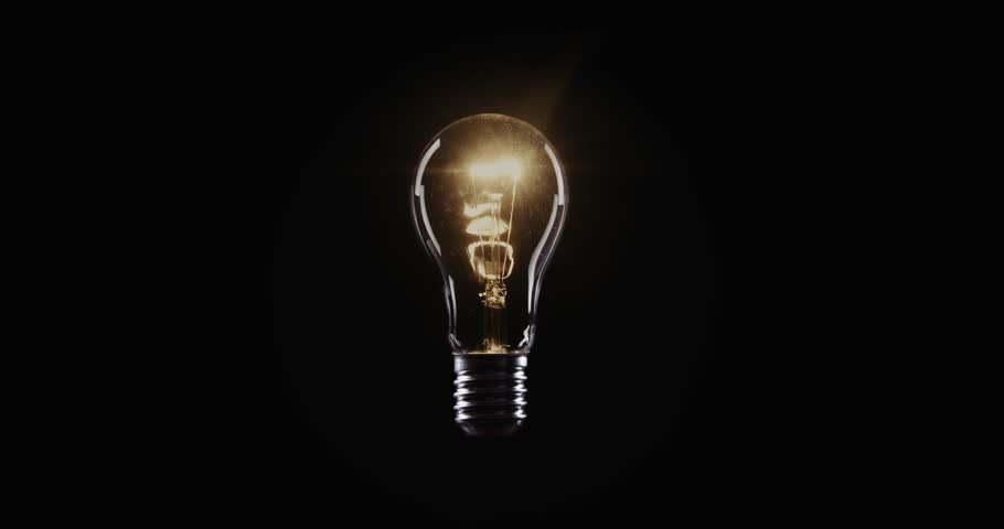 Flickering Tungsten light bulb lamp over black background | Shutterstock HD Video #1023192253