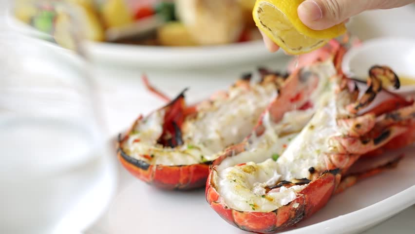 Squeeze the lemon juice on top delicious lobster.  | Shutterstock HD Video #1023192682