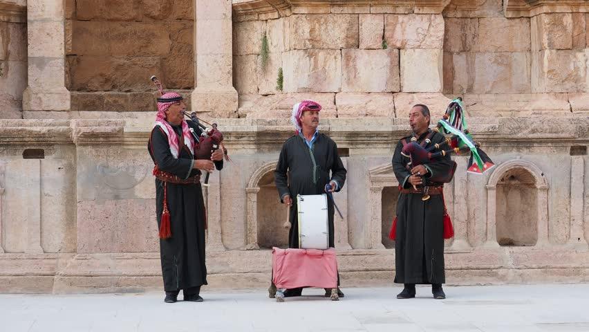 JERASH, JERASH GOVERNORATE, JORDAN - NOVEMBER 28, 2018: Jordanian Army Soldiers playing bagpipes at South Theater.