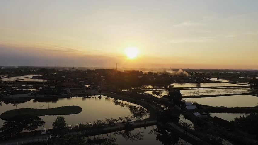 Ascending sunset with field background. Asian outdoor wild aerial establisher drone flight establishing shot | Shutterstock HD Video #1023204820