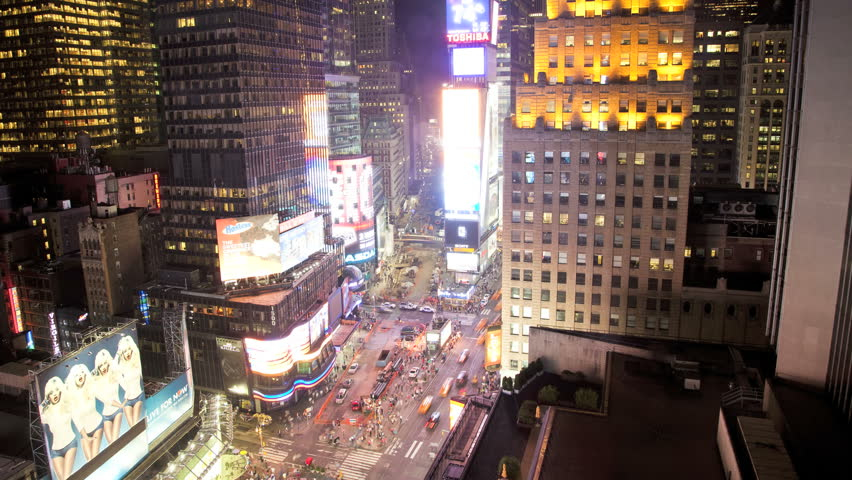 New York, USA - July 2013: Time lapse night time neon view Times Square, Manhattan, New York, USA   Shutterstock HD Video #1023207649