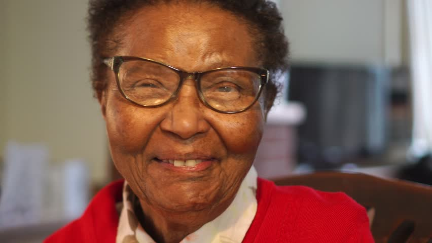 Portrait Of Happy African American Elderly Lady, Laughing And In Good Health, Slow Motion.