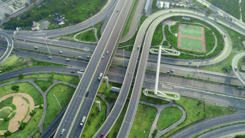 4K UHD vertical aerial top down view hyperlapse shot flying over heavy traffic on 4 freeway in Downtown, using a tilt shift effect. Thailand. | Shutterstock HD Video #1023235360