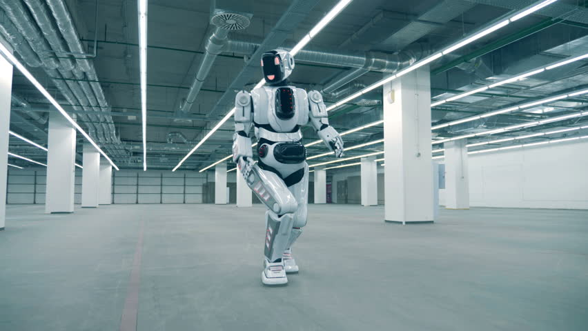 Empty spacious storage unit with a human-like cyborg walking along it | Shutterstock HD Video #1023238681