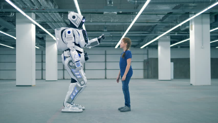 A girl and a robot are touching palms of each other | Shutterstock HD Video #1023238687