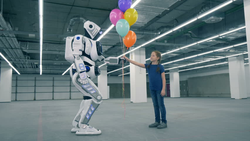 Robot is giving balloons to a girl and then touching her hand | Shutterstock HD Video #1023238918