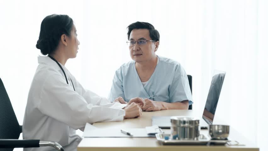 Doctor with patient. Young female medical doctor talking to a senior patient at hospital. Sharing medical test result via computer. Senior care medical and insurance concept. | Shutterstock HD Video #1023240601