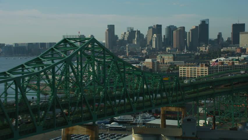 Boston, USA - November, 2017: Aerial view of the Tobin Memorial 2 tier road traffic vehicle bridge over the Mystic river city skyscrapers downtown Boston Massachusetts USA