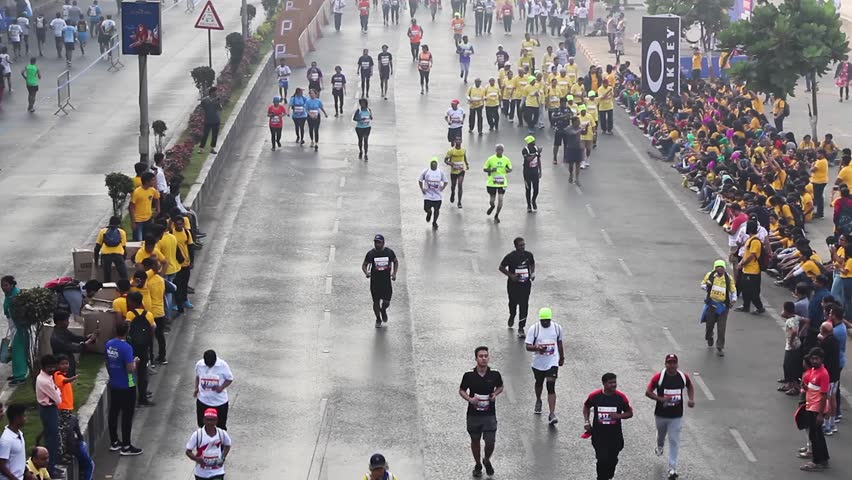Mumbai, Maharashtra India - January 20th 2019 : Overview shot of a crowd of 100s of people running on the streets of Marine Drive for Tata Mumbai Marathon TMM2019 on a cold foggy winter morning. | Shutterstock HD Video #1023267760