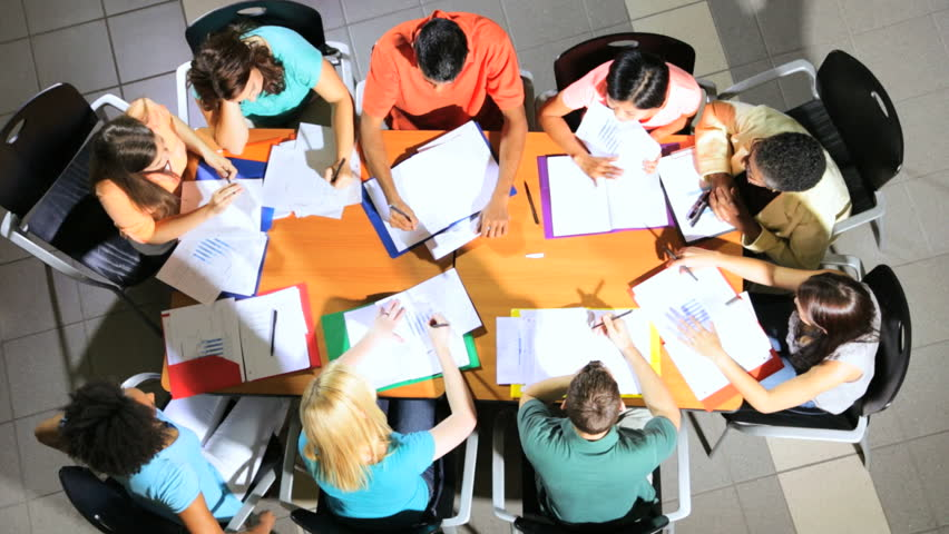 Overhead view African American female college tutor class multi ethnic teenage students applauding fellow students successful work #1023269902