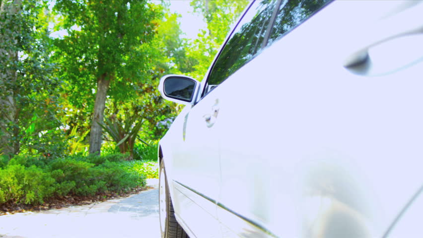 Close up Caucasian businessman arriving outside home luxury car