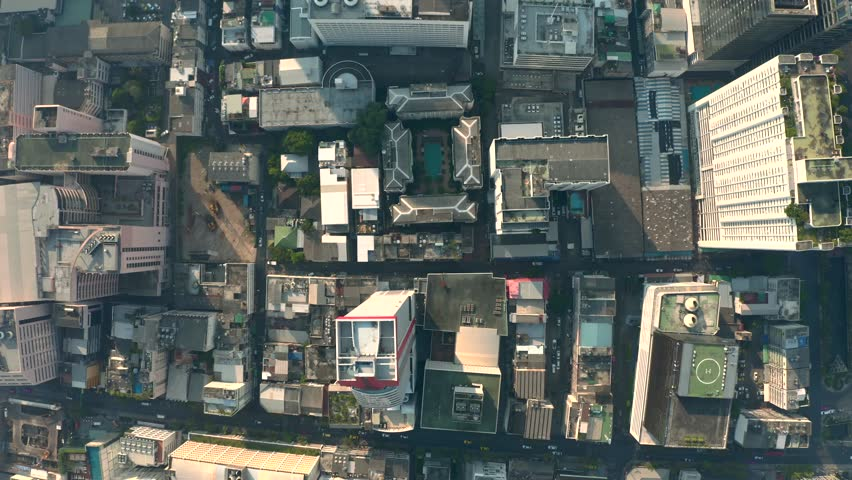 Aerial city view of Bangkok with crossroads and roads, houses, buildings and parking lots. Helicopter drone shot. #1023297670