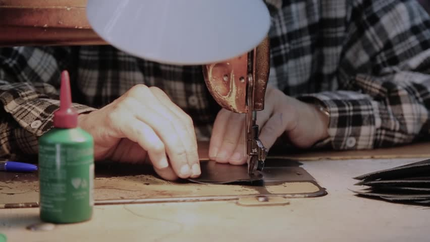 Tailoring shoes leather traditional profession in Tripoli Lebanon. Leather tailoring .50 FPS slow motion