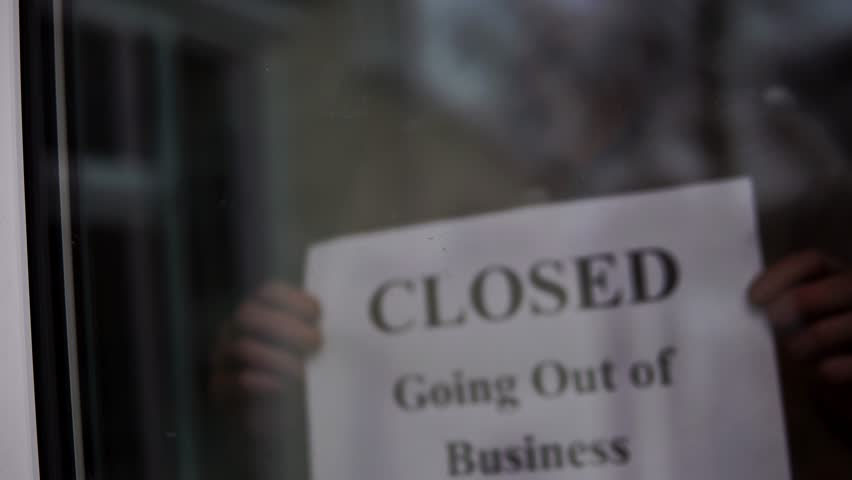 Closed Going Out Of Business Sign Placed At Store Front Window, 4K Recession.