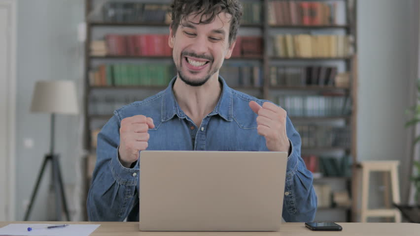 Excited Man Celebrating Success, Working on Laptop | Shutterstock HD Video #1023328171