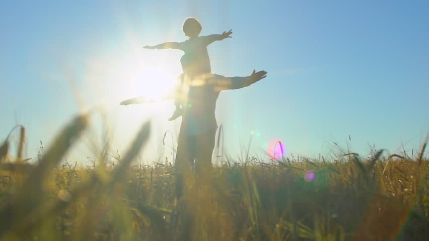 Silhouette of father and son playing, airplane arms raised at sunset in wheat field, happy family children flying outdoors. child little boy having fun, rising up hands, travel, holiday nature summer