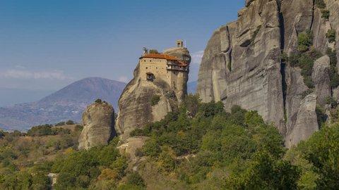 Timelapse 4k, incredible rock formations UNESCO World Heritage since 1988, The Monastery of St. Nicholas Anapavsa one of largest built of Eastern Orthodox in Meteora, Kalambaka, City Kastraki, Greece.