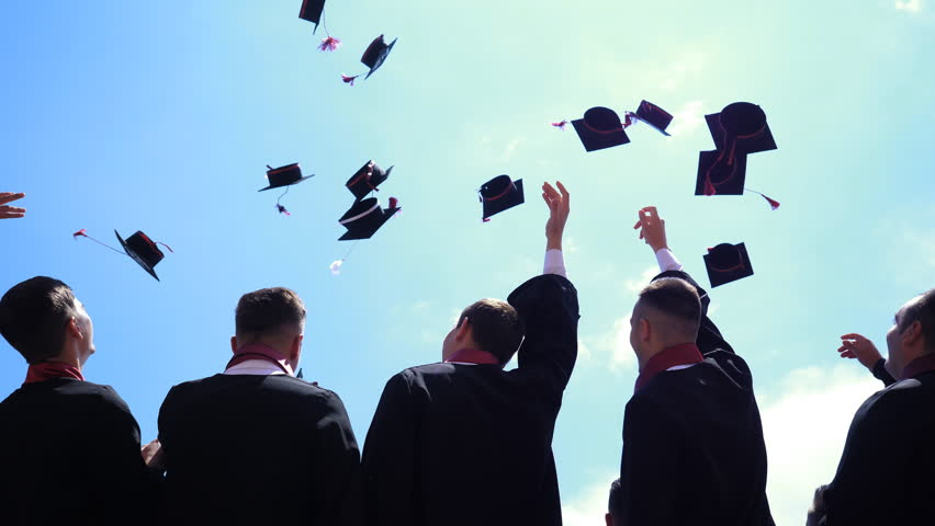 BRASOV, ROMANIA - JUNE 16, 2018: Students throw caps in the air at graduation