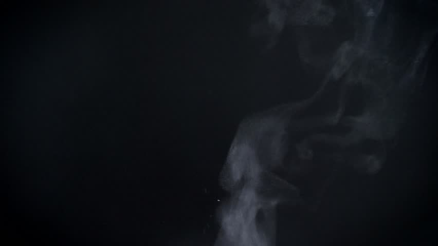 Closeup shot of vapouring smoke slowly flying on black background. #1023379087
