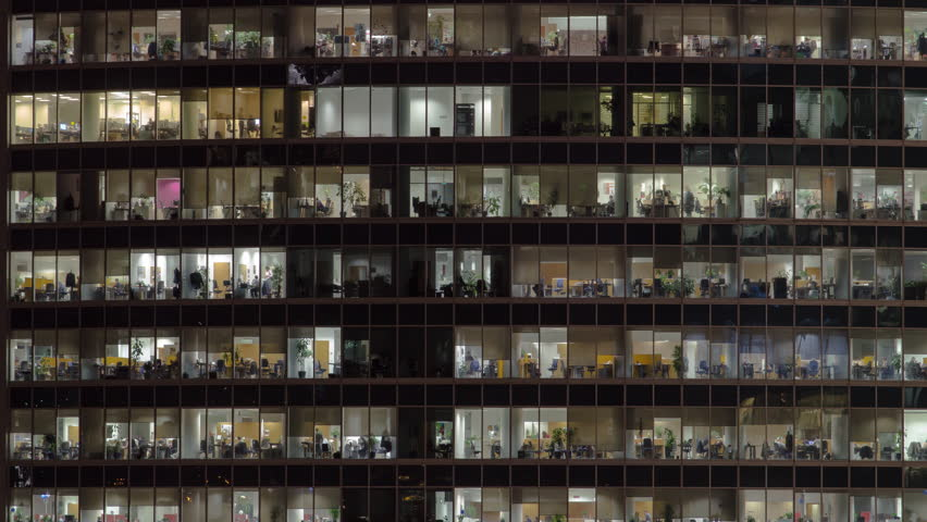 Close view to office windows in Skyscrapers International Business Center City at night with Moscow river timelapse from top, Moscow, Russia. Zoom in #1023385843