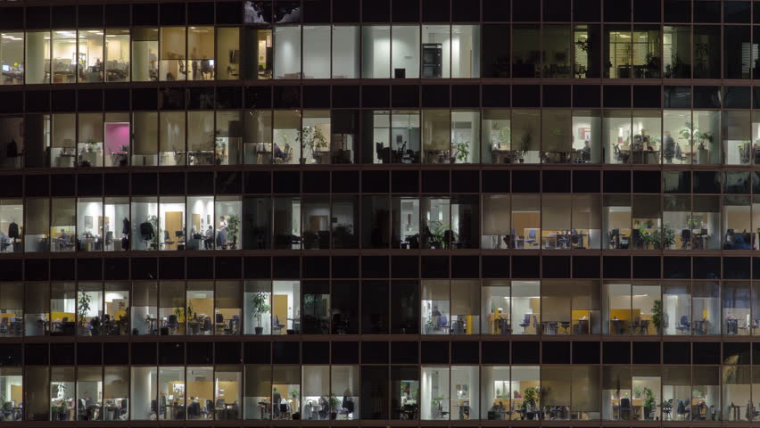 Close view to office windows in Skyscrapers International Business Center City at night with Moscow river timelapse from top, Moscow, Russia. Zoom out | Shutterstock HD Video #1023385846