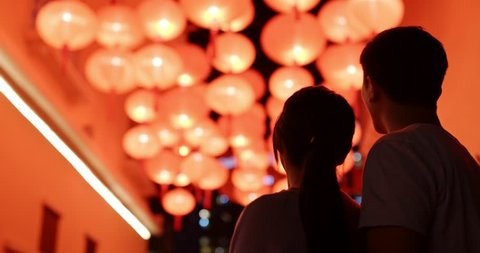Couple look at the beautiful red lantern for chinese new year at night
