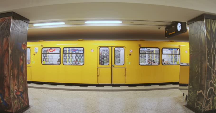 Berlin, Germany - 20 July, 2018: Doors of train closing. Underground station interior. Indoors, yellow line. Modern city, public transport, metro, speed, vehicle. Germany Berlin